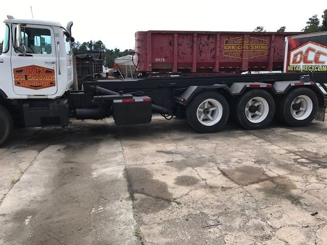 1990 Mack DM690S Roll Off
